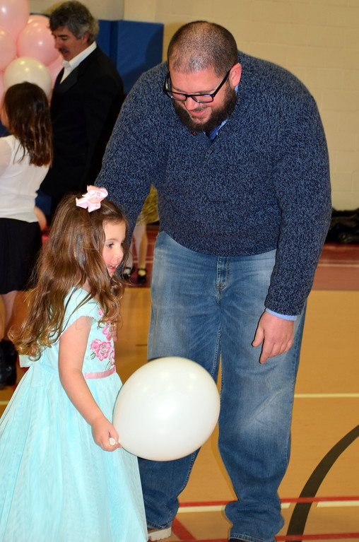 . Mallie Aulman and her dad, Tim, dance during their special fun night during the Daddy Daughter Dance at the Indian Valley Family YMCA Saturday, Feb. 11.  Debby High � For Digital First Media