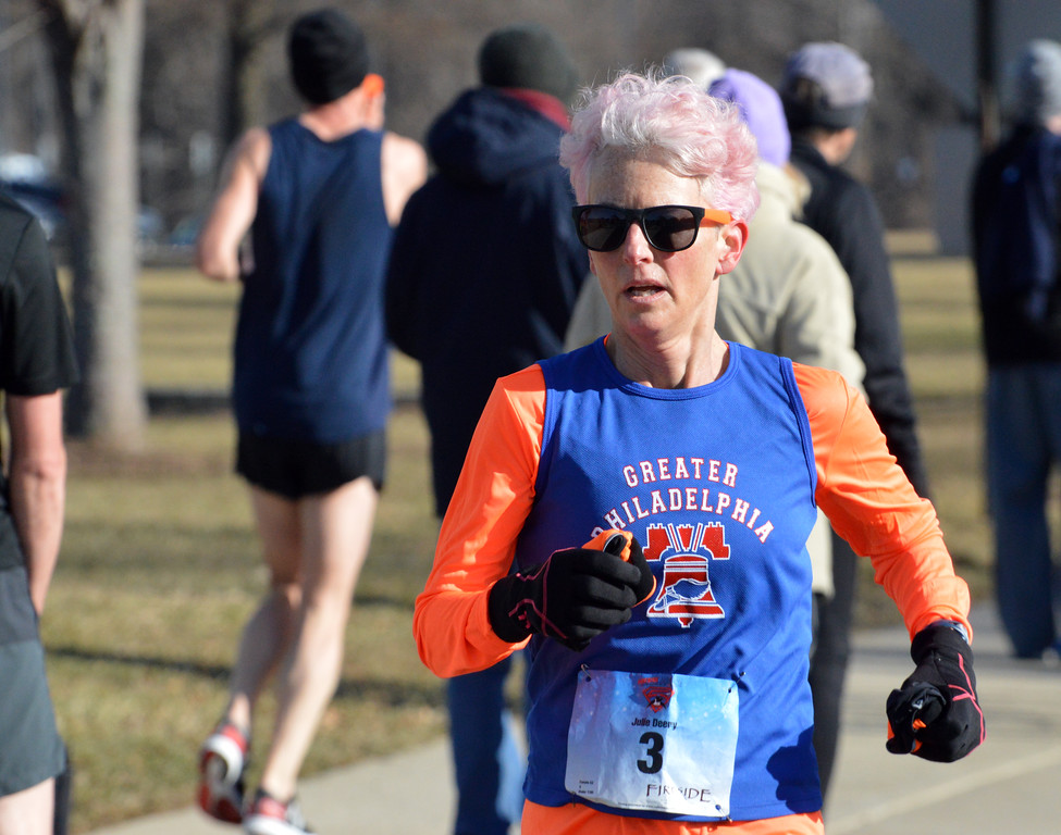. Runners take part in the Ambler Area Running Club�s annual Fireside Frostbite 5-Miler Feb. 17.  Debby High � For Digital First Media