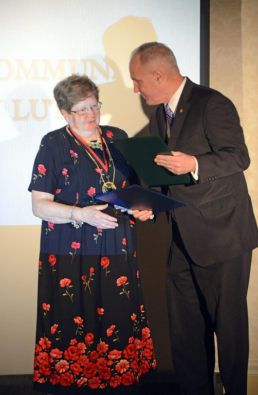 . State Rep. Thomas Murt, R-152, presents Beverly Lutz with the Service to the Community Award at the biennial Borough Ball March 4 at the Spring Mill Country Club in Ivyland.  Christine Wolkin � For Digital First Media