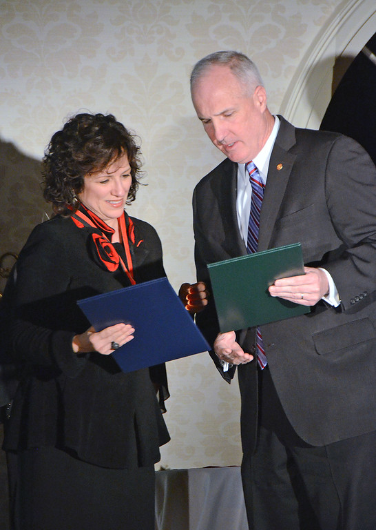 . State Rep. Thomas Murt, R-152, presents Kim Rubenstein with the Service to the Youth Award at the biennial Borough Ball March 4.  Christine Wolkin � For Digital First Media