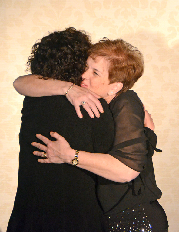 . Kathleen Salemno, right, embraces fellow Service to Community award winner Kim Rubenstein during the Greater Hatboro Chamber of Commerce Borough Ball March 4 at Spring Mill Country Club in Ivyland.  Christine Wolkin � For Digital First Media