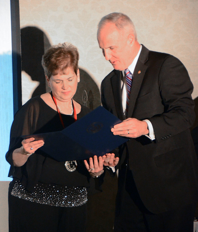. State Rep. Thomas Murt, R-152, presents the Service to Business Award is presented to Kathleen Salemno, executive board secretary for the Greater Hatboro Chamber of Commerce.  Christine Wolkin � For Digital First Media