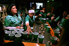 """Allison McDonald Zajatz, left, updates everyone on the news since the last pub crawl as her sister, Sadie McDonald, Makes sure all have a cup for """"the toast"""" at the 10th Annual Lansdale Pub Crawl March 18, 2017.  (Bob Raines--Digital First Media)"""