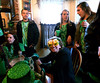 Taylor Goettner, seated right, models a pair of beer mug eyeglasses at the McDonald house, Lansdale for the 10th Annual Lansdale Pub Crawl March 18, 2017.  (Bob Raines--Digital First Media)