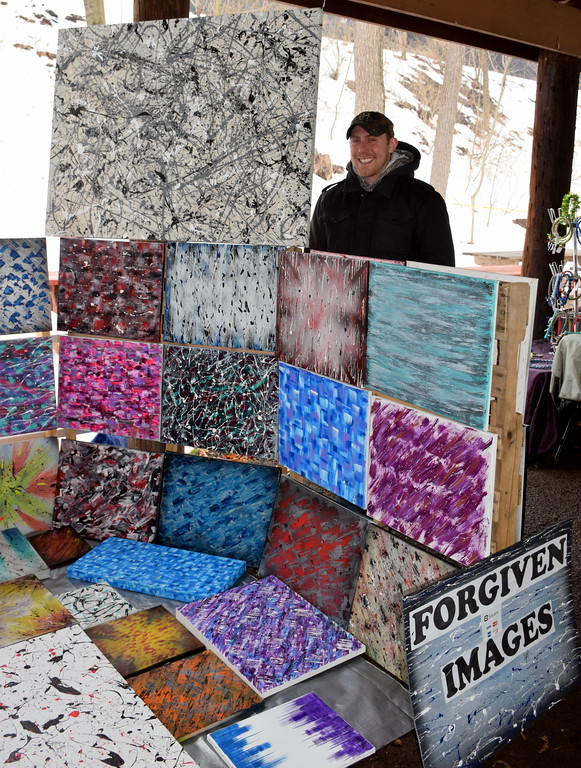 . Justin Reeves, artist and owner of Forgiven Images, mans a booth at the Pennridge Celtic Fest at the Sellersville Fire Company Picnic Grove Saturday, March 18.  Debby High � For Digital First Media