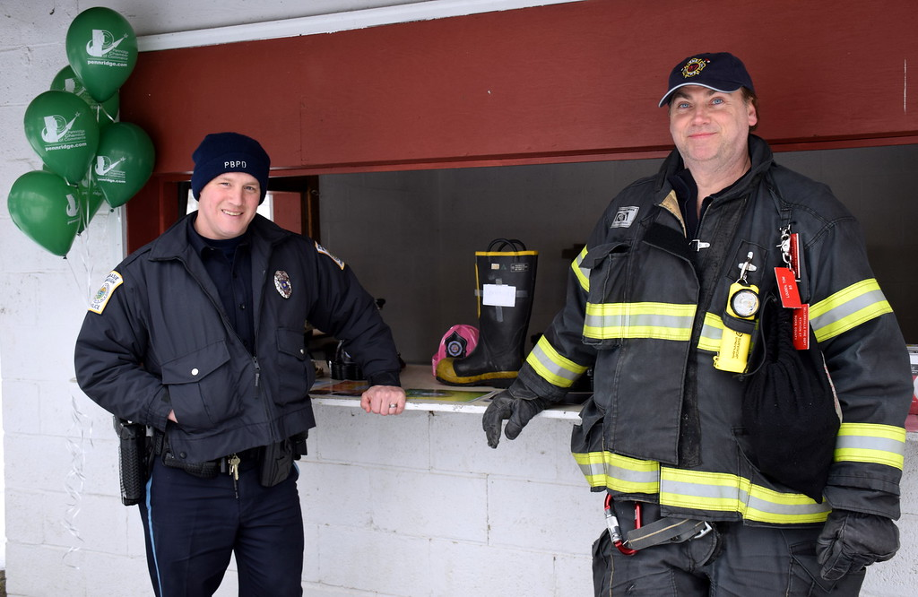 . Perkasie Borough police Officer Ryan Richardson and Sellersville Fire Deparment Assistant Chief Tom Louden man the fire prevention booth at the Pennridge Celtic Fest at the Sellersville Fire Company Picnic Grove Saturday, March 18.  Debby High � For Digital First Media