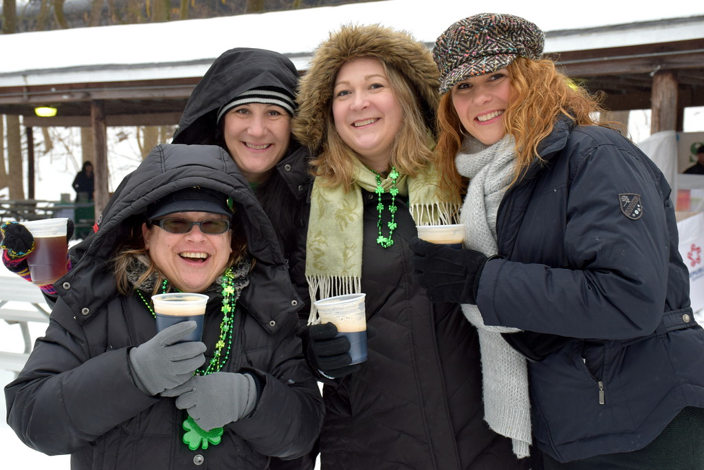 . Attendees enjoy a beer during the Pennridge Celtic Fest at the Sellersville Fire Company Picnic Grove Saturday, March 18.  Debby High � For Digital First Media