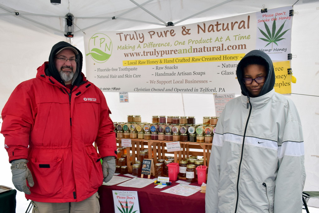 . Nick Perna of Truly Pure & Natural�s booth and his daughter, Jadyn Grace, man a booth at the Pennridge Celtic Fest at the Sellersville Fire Company Picnic Grove Saturday, March 18.  Debby High � For Digital First Media
