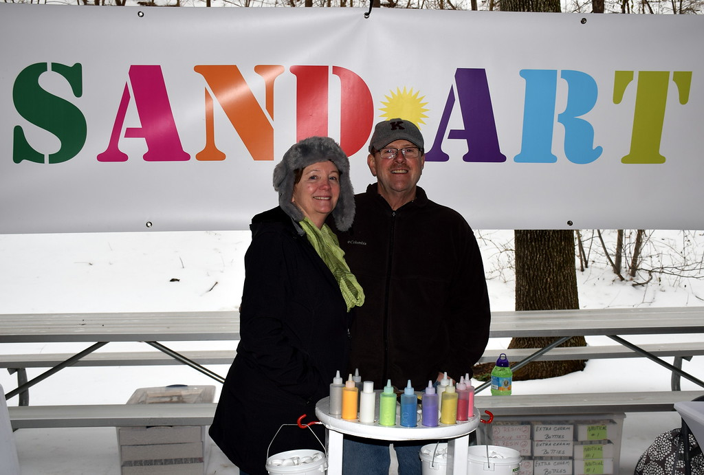 . Jo and Mike Goodenough of Art of Sand man a booth at the Pennridge Celtic Fest at the Sellersville Fire Company Picnic Grove Saturday, March 18.  Debby High � For Digital First Media