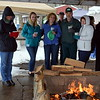 Attendees keep warm by the yule log fire provided by the Sellersville Fire Department during the Pennridge Celtic Fest at the Sellersville Fire Company Picnic Grove Saturday, March 18.  Debby High — For Digital First Media