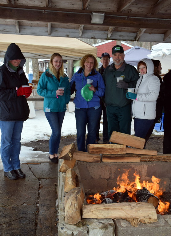 . Attendees keep warm by the yule log fire provided by the Sellersville Fire Department during the Pennridge Celtic Fest at the Sellersville Fire Company Picnic Grove Saturday, March 18.  Debby High � For Digital First Media
