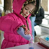 Megan Chodoroff makes sand art with rainbow colors at the Pennridge Celtic Fest at the Sellersville Fire Company Picnic Grove Saturday, March 18.  Debby High — For Digital First Media