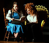 Belle (Via Dell'Angelo) reads to Beast (Frankie Wiemelt) after he admits that he cannot.  (Bob Raines / Digital First Media)