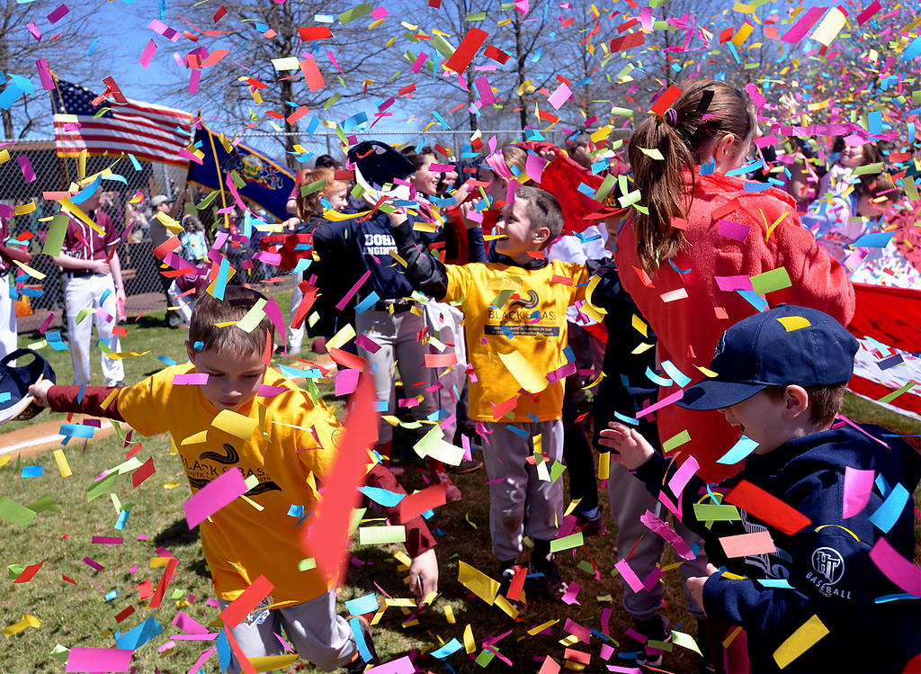 . (Bob Raines--Digital First Media)___ Players are showered with confetti as the finale of the Hatfield-Towamencin Opening Day April 8, 2017.