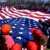 (Bob Raines--Digital First Media)___<br /> Players stretch out a huge American flag on opening day of the Hatfield-Towamencin Little League season April 8, 2017.
