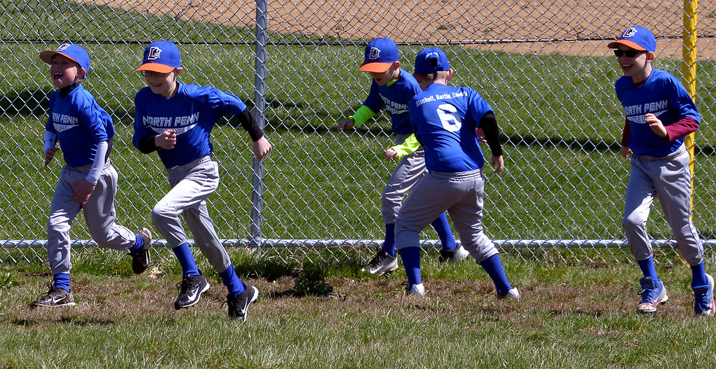 . (Bob Raines--Digital First Media)___ Durham Bulls little leaguers limber up on the North Penn Little League Opening Day April 8, 2017.