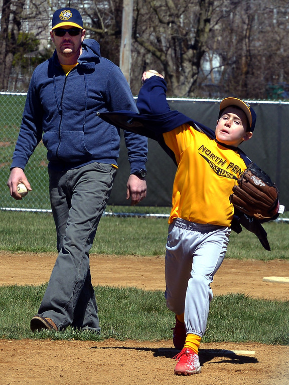 . Bob Raines--Digital First MediaYellow Jackets pitcher Rylan Weed gets in some  practice with guidance from coach Jack Horgan on North Penn Little League Opening Day April 8, 2017.