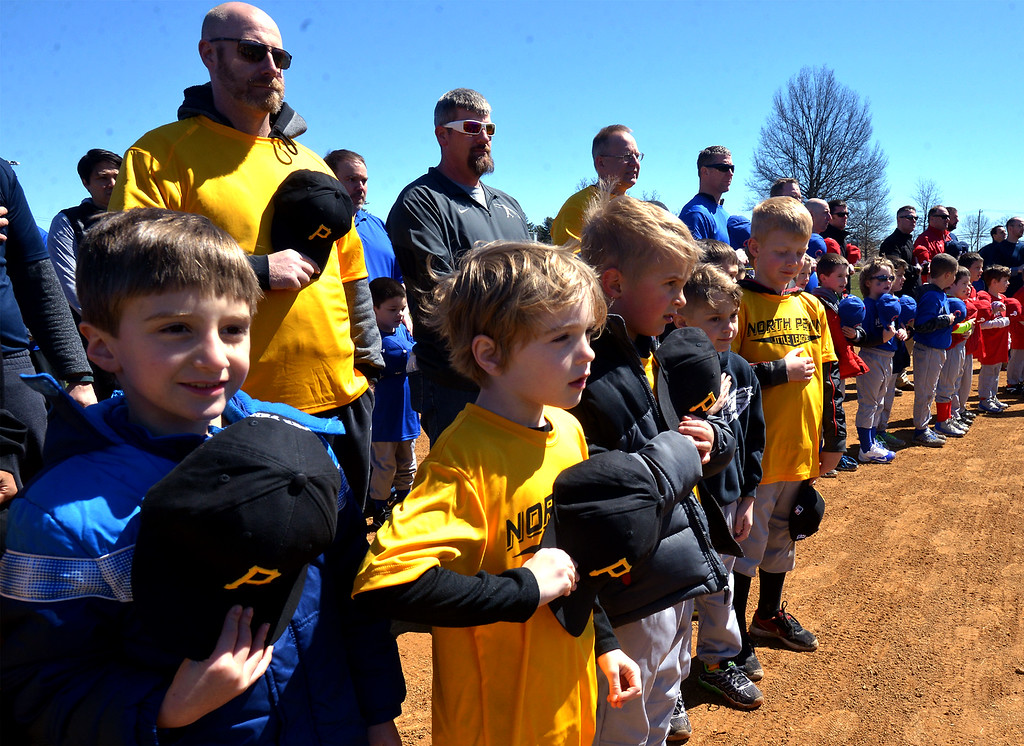 . (Bob Raines--Digital First Media)___ Players and coaches stand with their hats over their heart during the national anthem at the North Penn Little League Opening Day April 8, 2017.