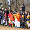 Little League players and coaches hold their baseball caps over their hearts during the singing of the national anthem.  Rachel Wisniewski — For Digital First Media