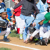 Players on the boys light blue and green Little League teams play around on the field while awaiting the start of the ceremony.  Rachel Wisniewski — For Digital First Media