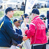Brett Date, the manager of the Cheltenham Intermediate Travel Team, receives a handshake and a trophy from Mark Kelly, director of baseball within the Cheltenham Little League. The Intermediate Travel Team was the champion of the Montgomery County Travel League in 2016. All of the team's players received trophies as a part of the opening day ceremony.  Rachel Wisniewski — For Digital First Media