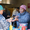"""Lisa Desphy hands a hot dog to a customer at the Little League snack stand. Desphy has been volunteering in the stand for four years now. For opening day, the stand ran a """"Dollar Dog Day"""" special.  Rachel Wisniewski — For Digital First Media"""