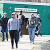 Parents of Cheltenham Little League players make their way down to the ball field in order to witness their sons and daughters in the opening day parade. In the background is Cassell Garage, a garage that was dedicated to longtime Little League supporter Ed Cassell last year. Cassell recently passed away following a fight with cancer.  Rachel Wisniewski — For Digital First Media