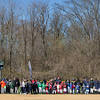 Boys and girls in the Little League line up along the edge of the field to view the morning's ceremony.  Rachel Wisniewski — For Digital First Media