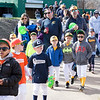 Cheltenham Little League players and coaches make their way down to the field in the opening day parade.  Rachel Wisniewski — For Digital First Media