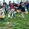 Youngsters run to collect Easter eggs during Faith at Sellersville's Easter Egg-Splosion Saturday, April 15.  Debby High — Digital First Media