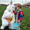 Liam Becker, of Sellersvilles, high-fives the Easter Bunny at Faith at Sellersville's annual Easter Egg-Splosion Saturday, April 15.  Debby High — Digital First Media