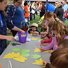 Children work on craft projects at Faith at Sellersville's annual Easter Egg-Splosion Saturday, April 15.  Debby High — Digital First Media