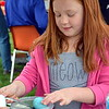 Brea Tarantino dyes eggs at Faith at Sellersville's annual Easter Egg-Splosion Saturday, April 15.  Debby High — Digital First Media