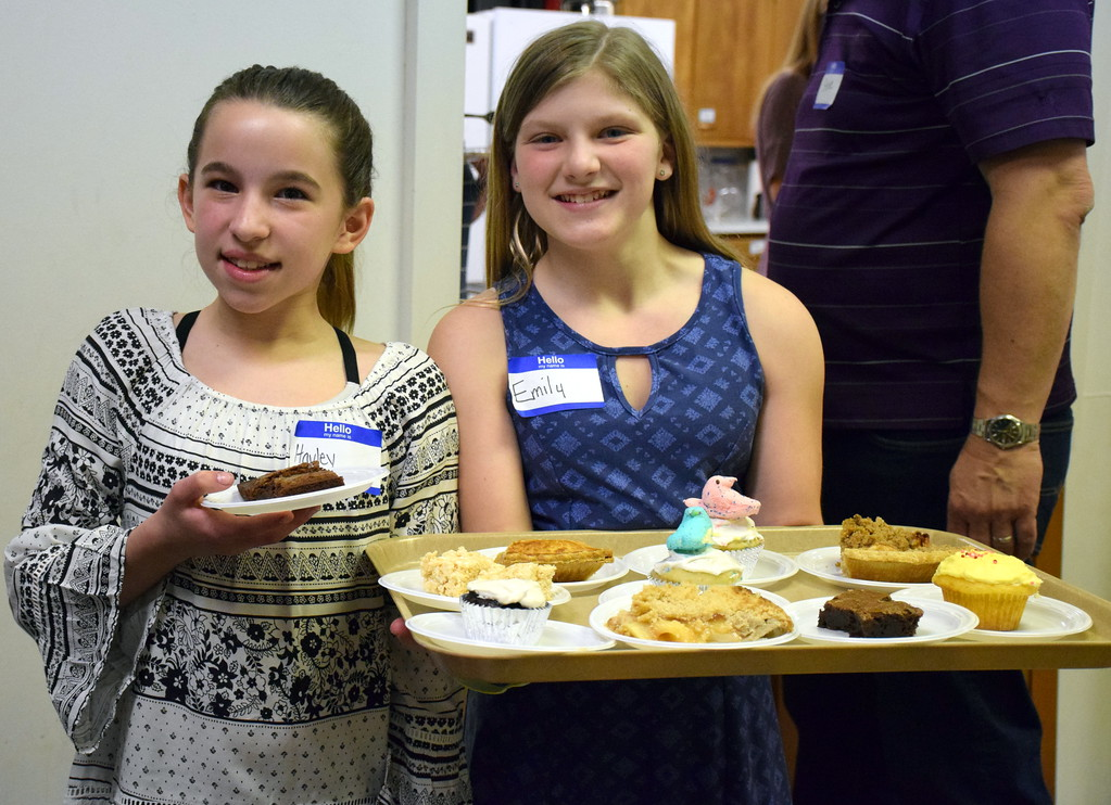 . Young volunteers serve desserts annual free community Easter dinner at Grace Bible Church in Souderton Saturday, April 15.  Debby High � For Digital First Media