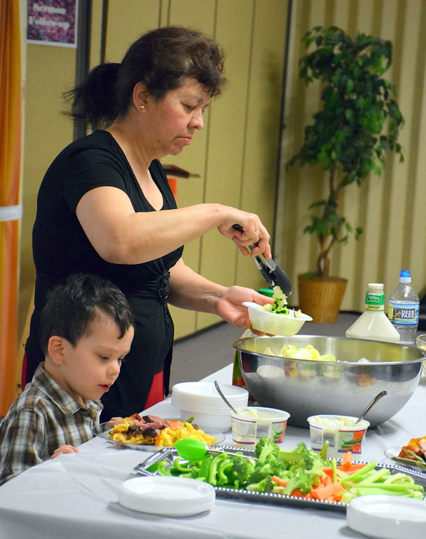 . Families enjoy the annual free community Easter dinner at Grace Bible Church in Souderton Saturday, April 15.  Debby High � For Digital First Media