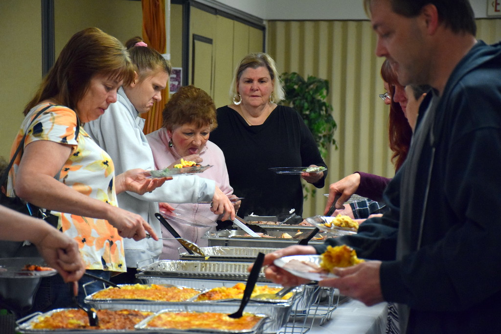 . More than 100 people enjoy the annual free community Easter dinner at Grace Bible Church in Sounderton Saturday, April 15.  Debby High � For Digital First Media