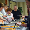 More than 100 people enjoy the annual free community Easter dinner at Grace Bible Church in Sounderton Saturday, April 15.  Debby High — For Digital First Media