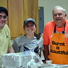Scott Pawling, Becca Renner and Bob Tybring serve as the cooking crew for the annual free community Easter dinner at Grace Bible Church in Souderton Saturday, April 15.  Debby High — For Digital First Media