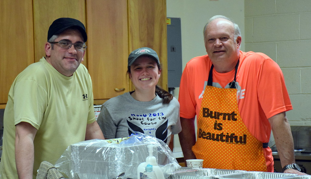 . Scott Pawling, Becca Renner and Bob Tybring serve as the cooking crew for the annual free community Easter dinner at Grace Bible Church in Souderton Saturday, April 15.  Debby High � For Digital First Media