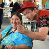 Cindy Godwin and her son, James enjoy the annual free community Easter dinner at Grace Bible Church in Souderton Saturday, April 15.  Debby High — For Digital First Media