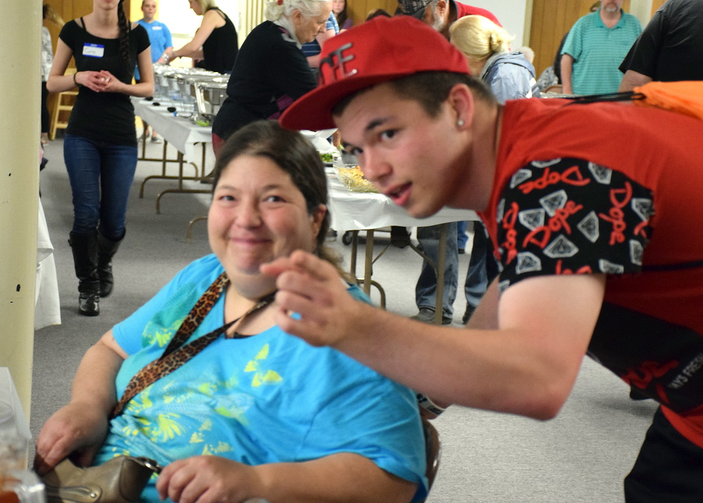 . Cindy Godwin and her son, James enjoy the annual free community Easter dinner at Grace Bible Church in Souderton Saturday, April 15.  Debby High � For Digital First Media