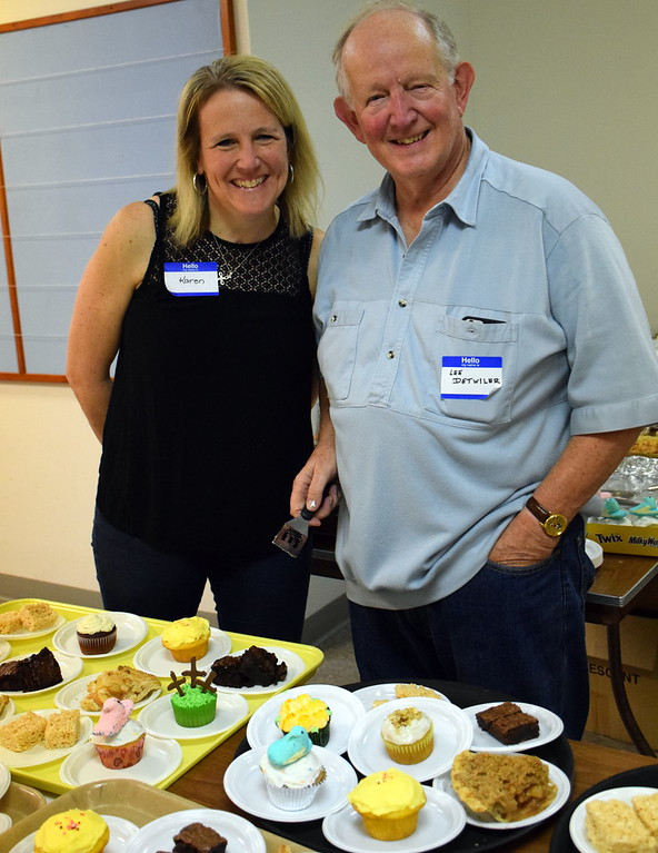 . Karen Renner and her dad, Lee Detwiler, volunteer during the annual free community Easter dinner at Grace Bible Church in Souderton Saturday, April 15.  Debby High � For Digital First Media