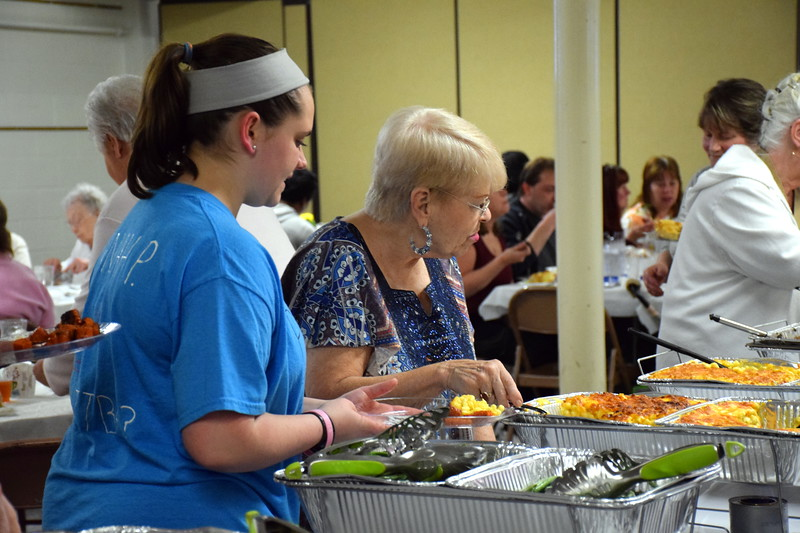 Volunteers help with the annual free community Easter dinner at Grace Bible Church in Souderton Saturday, April 15.  Debby High — For Digital First Media