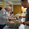 Grace Bible Church volunteers gather plates to serve during the annual free community Easter dinner at Grace Bible Church in Souderton Saturday, April 15.  Debby High — For Digital First Media