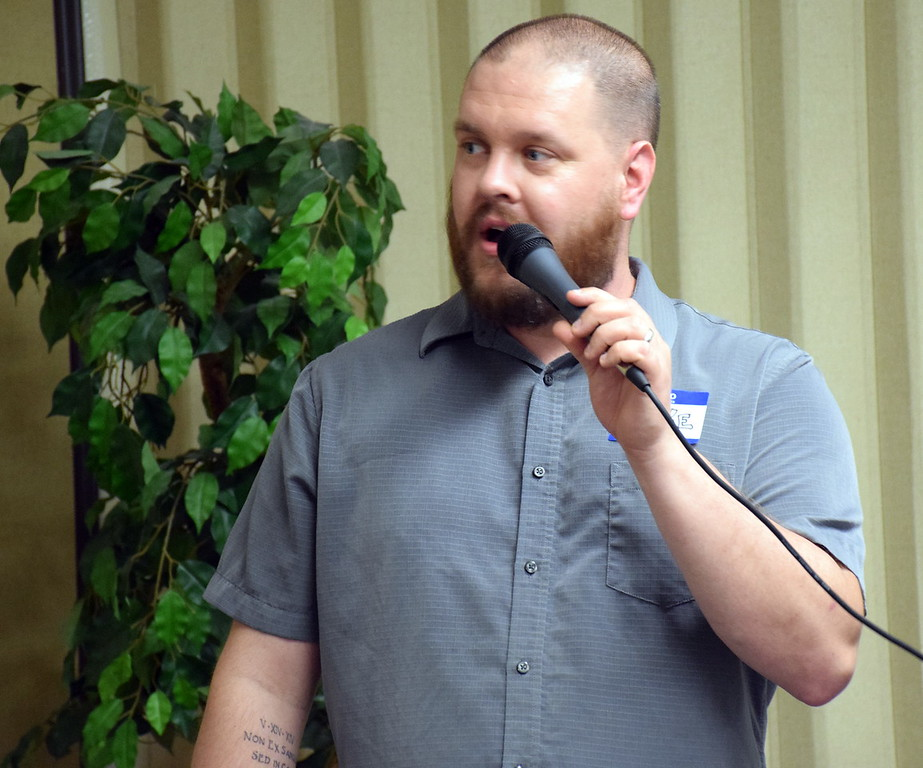 . Luke Bennett speaks before the meal is served at Grace Bible Church in Souderton�s annual free community Easter dinner Saturday, April 15.  Debby High � For Digital First Media