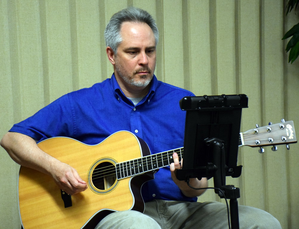 . Jeff Woertz performs during annual free community Easter dinner at Grace Bible Church in Souderton Saturday, April 15.  Debby High � For Digital First Media
