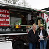 Denise Darrell and Debbie Ebert enjoy the Nick's Northeast food truck at the Perkaise popup park Saturday, April 22.  Debby High — For Digital First Media