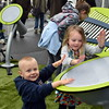 Killian Grzyminski, 2, and Mia Barlow, 4, play on the outdoor instruments at the Perkasie popup park.  Debby High — For Digital First Media