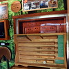 The Pennsylvania Department of Agriculture presents a display about the history of wooden bats at the Perkasie popup park.  Debby High — For Digital First Media