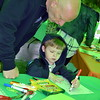 Bob Grajewski colors with his grandson, Landyn Keating, under the green tent at the Perkasie popup park Saturday, April 22.  Debby High — For Digital First Media